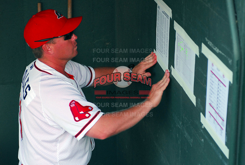 August 13, 2009: Manager Kevin Boles (19) of the Greenville Drive posts the lineups in the dugout before a game against the Greensboro Grasshoppers at Fluor Field at the West End in Greenville, S.C. Photo by: Tom Priddy/Four Seam Images
