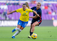 ORLANDO, FL - FEBRUARY 21: Andressinha #17 of Brazil fights for the ball with Lindsey Horan #9 of the USWNT during a game between Brazil and USWNT at Exploria Stadium on February 21, 2021 in Orlando, Florida.