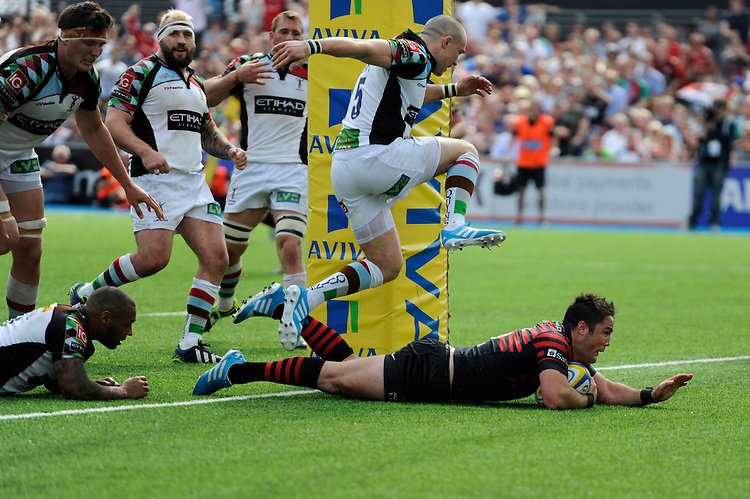 Brad Barritt of Saracens dives over to score a try during the Aviva Premiership semi final match between Saracens and Harlequins at Allianz Park on Saturday 17th May 2014 (Photo by Rob Munro)