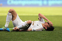 Jack Cork of Swansea City injured on the ground during the Swansea City FC v Manchester City Premier League game at the Liberty Stadium, Swansea, Wales, UK, Sunday 15 May 2016