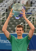 DELRAY BEACH, FLORIDA - JANUARY 13: Hubert Hurkacz of Poland celebrates with the championship trophy after defeating Sebastian Korda 6-3 6-3 during the Finals of the Delray Beach Open at Delray Beach Tennis Center on January 13, 2021 in Delray Beach, Florida.. Credit: mpi04/MediaPunch