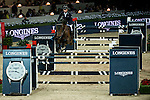 Denis Lynch of Ireland rides Querida in action at the Longines Grand Prix during the Longines Hong Kong Masters 2015 at the AsiaWorld Expo on 15 February 2015 in Hong Kong, China. Photo by Aitor Alcalde / Power Sport Images