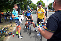 Stage five winner Mike Cuming (left) with tour top two Mike O'Brien (centre) and Ben O'Connor (yellow jersey) after the NZ Cycle Classic stage five of the UCI Oceania Tour in Masterton, New Zealand on Saturday, 23 January 2016. Photo: Dave Lintott / lintottphoto.co.nz