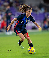 ORLANDO, FL - FEBRUARY 24: Kelley O'Hara #5 of the USWNT dribbles during a game between Argentina and USWNT at Exploria Stadium on February 24, 2021 in Orlando, Florida.