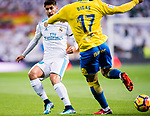 Marco Asensio Willemsen of Real Madrid (L) fights for the ball with Pedro Bigas Rigo of UD Las Palmas (R) during the La Liga 2017-18 match between Real Madrid and UD Las Palmas at Estadio Santiago Bernabeu on November 05 2017 in Madrid, Spain. Photo by Diego Gonzalez / Power Sport Images