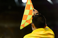 Harrison, NJ - Tuesday April 10, 2018: Assistant referee offsides flag during leg two of a  CONCACAF Champions League semi-final match between the New York Red Bulls and C. D. Guadalajara at Red Bull Arena. C. D. Guadalajara defeated the New York Red Bulls 0-0 (1-0 on aggregate).