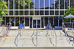 Wide staircase leads to glass front of modern buiding.  City of Aurburn, WA, USA City Hall.
