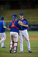 AZL Cubs catcher Marcus Mastrobuoni (5) congratulates relief pitcher Mitch Stophel (62) after ending the game against the AZL Diamondbacks on August 11, 2017 at Sloan Park in Mesa, Arizona. AZL Cubs defeated the AZL Diamondbacks 7-3. (Zachary Lucy/Four Seam Images)