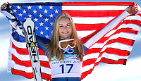 USA's Lindsey Vonn holds up an American flag after winning the bronze medal in the ladies' Super-G at the XXI Olympic Winter Games Saturday, February 20, 2010 in Whistler, British Columbia.