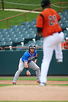 Akron RubberDucks left fielder Clint Frazier (4) leads off first base as pitcher Jayson Aquino (21) delivers a pitch during the first game of a doubleheader against the Bowie Baysox on June 5, 2016 at Prince George's Stadium in Bowie, Maryland.  Bowie defeated Akron 6-0.  (Mike Janes/Four Seam Images)