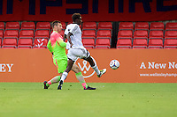 Goalkeeper Scott Brown of Wycombe Wanderers comes out to clear the ball from Bernard Mensah of Aldershot Town during the Friendly match between Aldershot Town and Wycombe Wanderers at the EBB Stadium, Aldershot, England on 26 July 2016. Photo by Alan  Stanford.