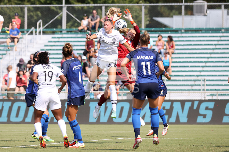 CARY, NC - SEPTEMBER 12: Casey Murphy #1 of the North Carolina Courage and Kelli Hubly #20 of the Portland Thorns FC challenge for the ball during a game between Portland Thorns FC and North Carolina Courage at Sahlen's Stadium at WakeMed Soccer Park on September 12, 2021 in Cary, North Carolina.