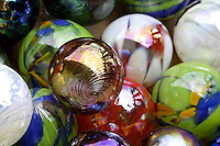 Colorful glass spheres represent the fine art of glassblowing at a studio in the town of Haleiwa on Oahu's north shore.