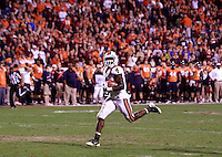 CHARLOTTESVILLE, VA- NOVEMBER 12: Running back David Wilson #4 of the Virginia Tech Hokies runs the ball in for a touchdown during the game against the Virginia Cavaliers on November 28, 2011 at Scott Stadium in Charlottesville, Virginia. Virginia Tech defeated Virginia 38-0. (Photo by Andrew Shurtleff/Getty Images) *** Local Caption *** David Wilson