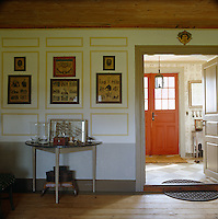 The front door to this Swedish country house is painted a deep rusty red