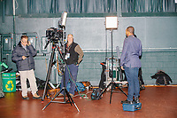 A television reporter prepares to report after a campaign rally for Democratic presidential candidate and Vermont senator Bernie Sanders at Hampshire Hills Athletic Club in Milford, New Hampshire, on Tue., Feb. 4, 2020. The  event started around 7pm and was the first event Sanders held after the previous day's Iowa Caucuses. The results of the caucuses were unknown until the Democratic party released partial numbers at 5pm, showing Sanders and former South Bend, Ind., mayor Pete Buttigieg both as frontrunners.