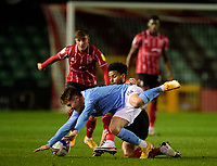 Lincoln City's Liam Bridcutt battles with Manchester City U21's Callum Doyle<br /> <br /> Photographer Andrew Vaughan/CameraSport<br /> <br /> EFL Papa John's Trophy - Northern Section - Group E - Lincoln City v Manchester City U21 - Tuesday 17th November 2020 - LNER Stadium - Lincoln<br />  <br /> World Copyright © 2020 CameraSport. All rights reserved. 43 Linden Ave. Countesthorpe. Leicester. England. LE8 5PG - Tel: +44 (0) 116 277 4147 - admin@camerasport.com - www.camerasport.com