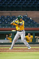 AZL Athletics shortstop Yerdel Vargas (5) bats during a game against the AZL Giants on August 5, 2017 at Scottsdale Stadium in Scottsdale, Arizona. AZL Athletics defeated the AZL Giants 2-1. (Zachary Lucy/Four Seam Images)