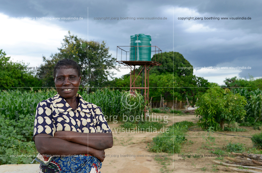 ZAMBIA, Mazabuka, Chikankata area, farmer practise conservation farming, farm of Christian Choomba and wife Mercy Malambo, behind water tank for irrigation