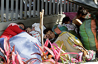 MEDELLÍN, COLOMBIA, MAY 14: Venezuelan immigrants sleeps outside the bus terminal in Medellín, Colombia, on May 14, 2020. Venezuelan migrants hope to have the opportunity to take a bus to the border due to the new pandemic. . from COVID19. (Photo by Fredy Builes / VIEWpress via Getty Images)