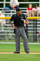 Home plate umpire Ronnie Whiting between innings of the Appalachian League game between the Greeneville Astros and the Burlington Royals at Burlington Athletic Park on July 1, 2013 in Burlington, North Carolina.  The Astros defeated the Royals 7-0 in Game One of a doubleheader.  (Brian Westerholt/Four Seam Images)