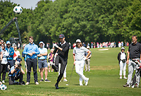 Pep Guardiola (Manchester City Manager) kicks a champions league ball as Tommy Fleetwood (England) looks on during the BMW PGA PRO-AM GOLF at Wentworth Drive, Virginia Water, England on 23 May 2018. Photo by Andy Rowland.