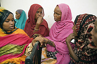 """Djibouti. Djibouti province. Djibouti. """"Oui à la vie"""" (Yes to life) was the first djiboutian association for seropositive people living with the HIV Aids disease. Portrait of six black seropositive muslim woman, wearing veils on their head. The Global Fund through the djiboutian Ministry of Health supports the programm with an Aids grant (financial aid).  © 2006 Didier Ruef"""