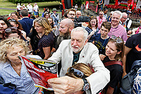 Pictured: Jeremy Corbyn signs a copy of Kerrang magazine issue which has its picture on its front cover. Sunday 01 July 2018<br /> Re: Labour Party leader Jeremy Corbyn at the celebration for the 70 years since the National Health Service (NHS) was founded by Aneurin Bevan, Bedwellty Park, Tredegar, Wales, UK.