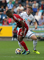 Andre Carrillo of Watford challenged by Alfie Mawson of Swansea City during the Premier League match between Swansea City and Watford at The Liberty Stadium, Swansea, Wales, UK. Saturday 23 September 2017