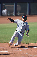 Scottsdale Scorpions shortstop Thairo Estrada (99), of the New York Yankees organization, slides safely into home plate during a game against the Peoria Javelinas on October 19, 2017 at Peoria Stadium in Peoria, Arizona. The Scorpions defeated the Javelinas 13-7.  (Zachary Lucy/Four Seam Images)