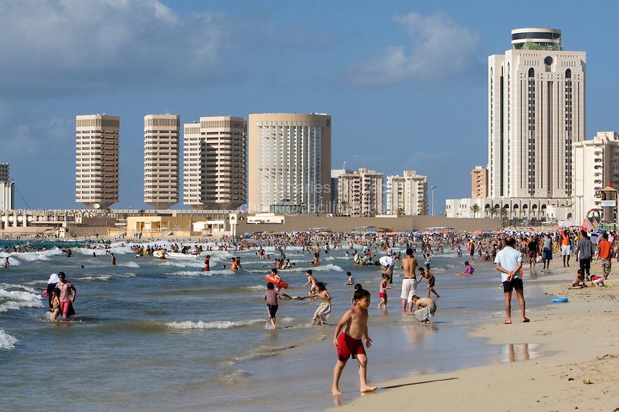 Tripoli, Libya - Mediterranean Beach Scene, Summer, Corinthia Hotel, Dhat al-Imad Office Buildings, Al-Fateh Tower