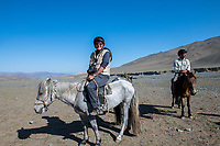 Mongolia, Bayan-Ulgii, Ulgii, Altai Mountains. Family in their yurt near Tsambagarav Mountain. Horse riding.