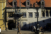 Bratislava, Slovakia. Workmen repairing the outside of the museum in the Old Town Hall.
