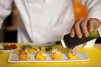 "Peruvian chef Gaston Acurio in his kitchen. Acurio is trying to remake Peru's traditional cuisine and export it as Japan did with sushi. Here, he prepares ""Causas de Gustacion"""