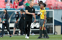 DENVER, CO - JUNE 3: Gregg Berhalter USA head coach shakes the refs hands after the gameof the United States and team mates celebrate during a game between Honduras and USMNT at EMPOWER FIELD AT MILE HIGH on June 3, 2021 in Denver, Colorado.