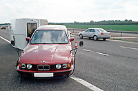 Remains of a car and caravan involved in a road traffic accident on the motorway. The car was travelling too fast and the caravan started to snake. Eventually, it jack-knifed and and dragged the car sideways down the road until it came to rest in front with the car lifted up in the air...© SHOUT. THIS PICTURE MUST ONLY BE USED TO ILLUSTRATE THE EMERGENCY SERVICES IN A POSITIVE MANNER. CONTACT JOHN CALLAN. Exact date unknown.john@shoutpictures.com.www.shoutpictures.com..