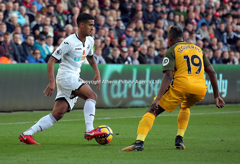(L-R) Kyle Naughton of Swansea City controls the ball away from Jose Izquierdo of Brighton during the Premier League match between Swansea City and Brighton and Hove Albion at The Liberty Stadium, Swansea, Wales, UK. Saturday 04 November 2017