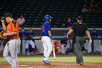 AZL Cubs designated hitter Yovanny Cuevas (61) argues with home plate umpire Ray Patchen after being called out for batter interference against the AZL Giants on September 6, 2017 at Sloan Park in Mesa, Arizona. AZL Giants defeated the AZL Cubs 6-5 to even up the Arizona League Championship Series at one game a piece. (Zachary Lucy/Four Seam Images)