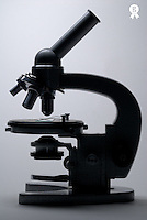 Microscope, close up, side view (Licence this image exclusively with Getty: http://www.gettyimages.com/detail/200437415-001 )