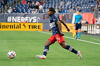 FOXBOROUGH, MA - MAY 16: DeJuan Jones #24 of New England Revolution during a game between Columbus SC and New England Revolution at Gillette Stadium on May 16, 2021 in Foxborough, Massachusetts.