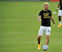 WASHINGTON, DC - SEPTEMBER 27: Diego Fagundez #14 of New England Revolution warming up during a game between New England Revolution and D.C. United at Audi Field on September 27, 2020 in Washington, DC.