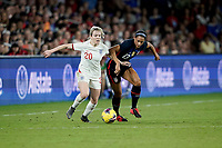 ORLANDO, FL - MARCH 05: Lauren Hemp #20 of England and Lynn Williams #13 of the United States during a game between England and USWNT at Exploria Stadium on March 05, 2020 in Orlando, Florida.