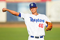 Corey Seager (46) of the Ogden Raptors warms up in the outfield prior to the game against the Orem Owlz at Lindquist Field on July 27, 2012 in Ogden, Utah.  Seager was selected in the 1st round (18th overall) of the 2012 First Year Player Draft by the Los Angeles Dodgers.   (Brian Westerholt/Four Seam Images)