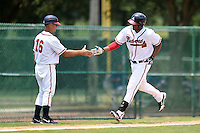 GCL Braves coach Rick Albert (16) congratulates designated hitter Edward Salcedo (25) after a home run during a game against the GCL Blue Jays on June 27, 2014 at the ESPN Wide World of Sports in Orlando, Florida.  GCL Braves defeated GCL Blue Jays 10-9.  (Mike Janes/Four Seam Images)