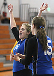 Marymount University's Johanna Hummel and Christine Gallart celebrate a point during college volleyball action at Goucher College in Towson, MD, on Saturday, Oct. 8, 2011.<br /> Photo by Cathleen Aliison