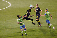 COLUMBUS, OH - DECEMBER 12: Nicolas Lodeiro #10 of Seattle Sounders FC battles for the ball against Harrison Afful #25 of Columbus Crew during a game between Seattle Sounders FC and Columbus Crew at MAPFRE Stadium on December 12, 2020 in Columbus, Ohio.
