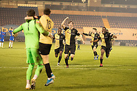 The Marine players rush to celebrate with Michael Howard, Marine AFC and goalkeeper Bayleigh Passant during Colchester United vs Marine, Emirates FA Cup Football at the JobServe Community Stadium on 7th November 2020