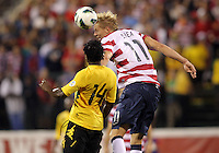 COLUMBUS, OHIO - SEPTEMBER 11, 2012:  Brek Shea (11) of the USA MNT heads over Lovel Palmer (14) of  Jamaica during a CONCACAF 2014 World Cup qualifying  match at Crew Stadium, in Columbus, Ohio on September 11. USA won 1-0.