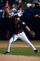 Grahamm Wiest #12 of the Cal State Fullerton Titans pitches against the Nebraska Cornhuskers at Goodwin Field on February 16, 2013 in Fullerton, California. Cal State Fullerton defeated Nebraska 10-5. (Larry Goren/Four Seam Images)