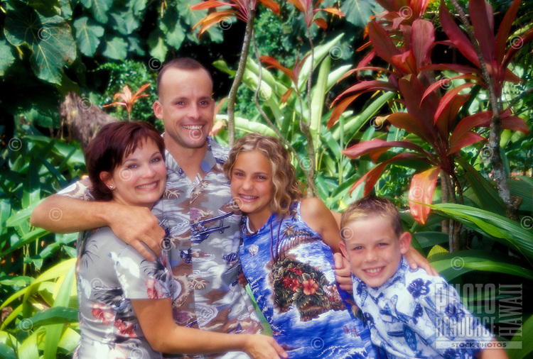 Tourist family gathered for a portrait at Haiku Gardens in Kaneohe, Hawaii